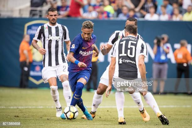 Neymar of Barcelona weaves through Mehdi Benatia of Juventus and Andrea Barzagli of Juventus during the International Champions Cup match between FC...