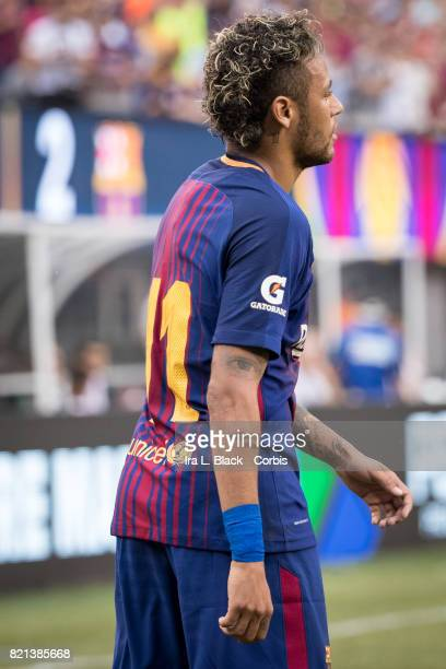 Neymar of Barcelona with the score in the background after his second goal of the match during the International Champions Cup match between FC...
