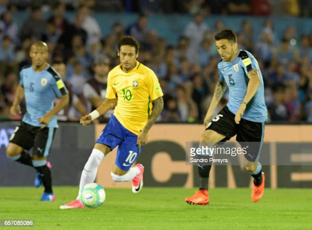 Neymar of Brasil and Matias Vecino of Uruguay fight for the ball during a match between Uruguay and Brazil as part of FIFA 2018 World Cup Qualifiers...