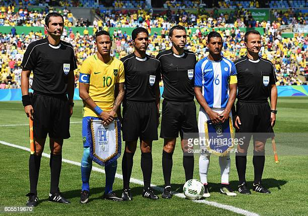Neymar of Brazil and Bryan Acosta of Honduras pose with the referee and his assistants during the Olympic Men's semi final match between Brazil and...