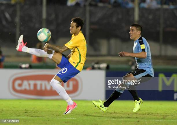 Neymar of Brazil and Maximiliano Pereira of Uruguay fight for the ball during a match between Uruguay and Brazil as part of FIFA 2018 World Cup...