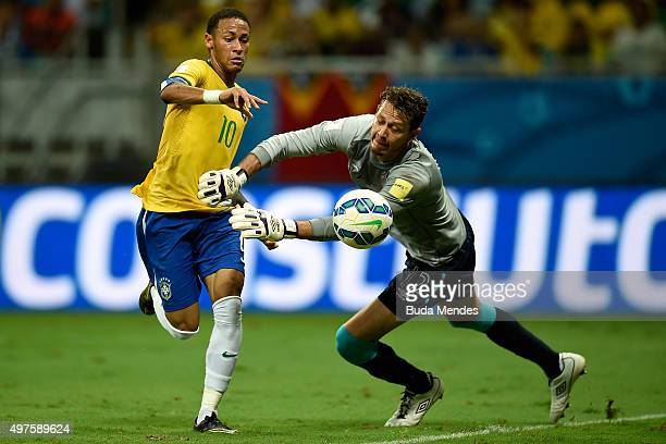 Neymar of Brazil battles for the ball with goalkeeper Diego Penny of Peru during a match between Brazil and Peru as part of 2018 FIFA World Cup...
