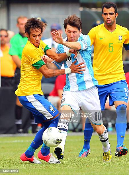 Neymar of Brazil battles Lionel Messi of Argentina during the first half of an international friendly soccer match on June 9 2012 at MetLife Stadium...