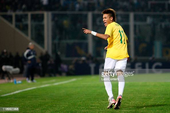 Neymar of Brazil celebrates a scored goal against Ecuador as part a match of Group B of Copa America 2011 at the Mario Kempes Stadium on July 13 2011...