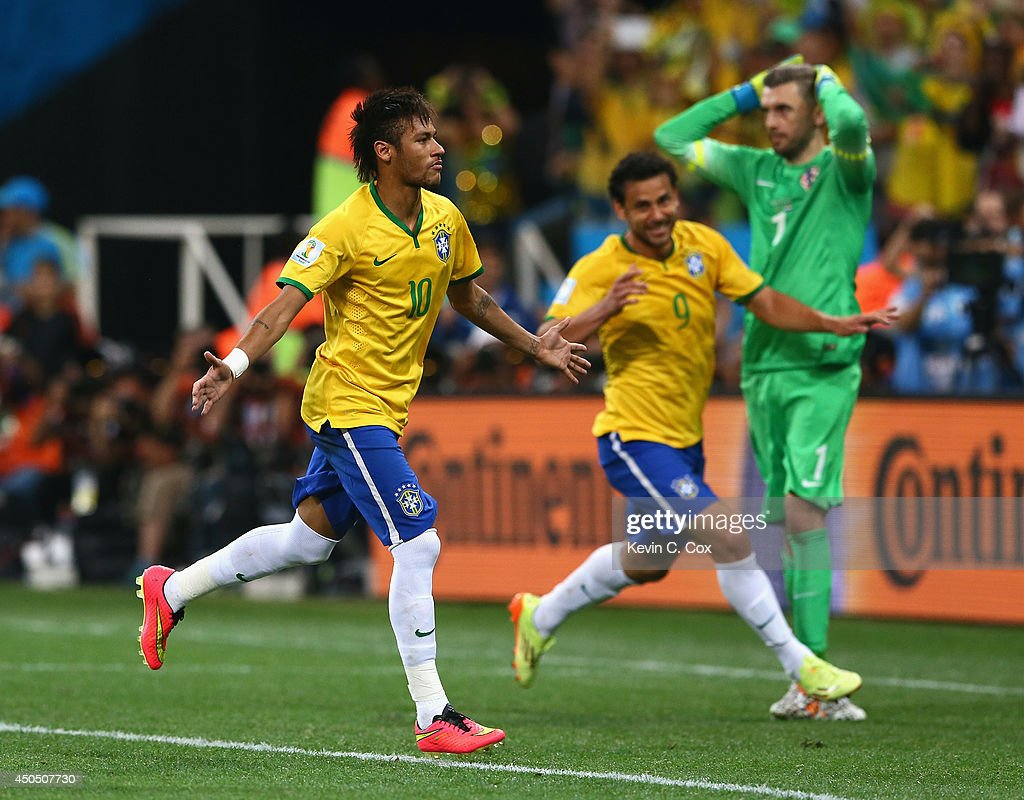 Neymar of Brazil celebrates after scoring his second goal with Fred as Stipe Pletikosa of Croatia looks on during the 2014 FIFA World Cup Brazil...