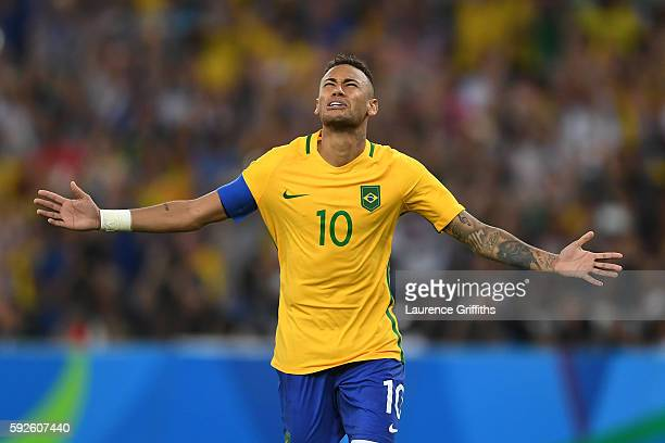Neymar of Brazil celebrates after scoring the winning penalty in the shoot out during the Men's Football Final between Brazil and Germany at the...