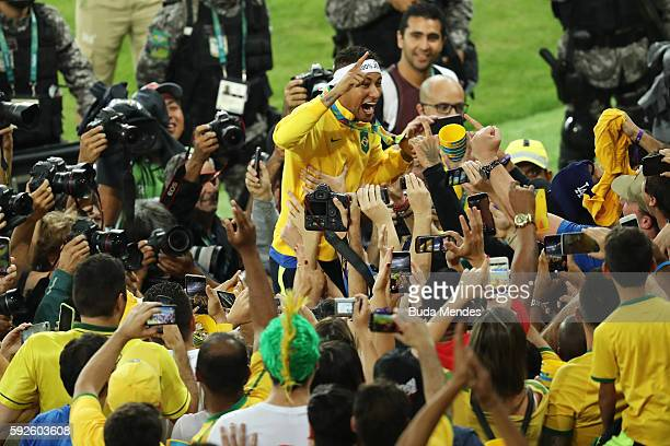 Neymar of Brazil celebrates after the Men's Football Final between Brazil and Germany at the Maracana Stadium on Day 15 of the Rio 2016 Olympic Games...