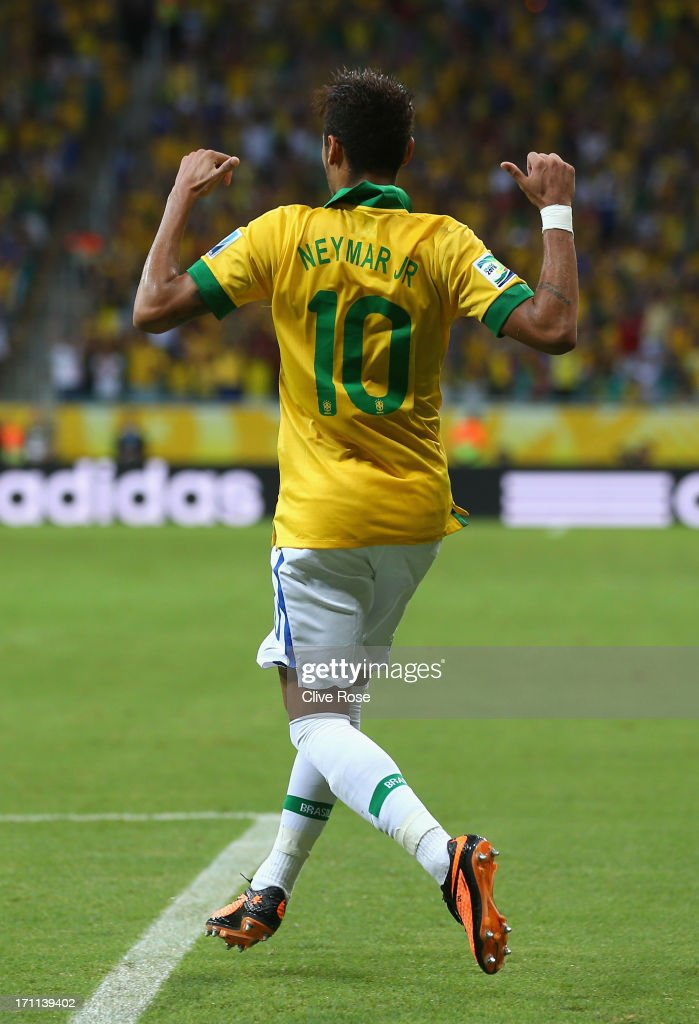 Neymar of Brazil celebrates as he scores their second goal from a free kick during the FIFA Confederations Cup Brazil 2013 Group A match between Italy and Brazil at Estadio Octavio Mangabeira (Arena Fonte Nova Salvador) on June 22, 2013 in Salvador, Brazil.