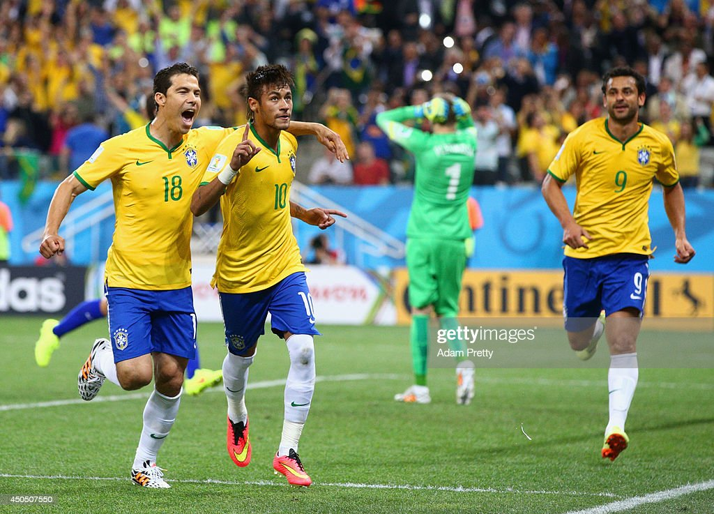 Neymar of Brazil (C) celebrates his second goal with <a gi-track='captionPersonalityLinkClicked' href=/galleries/search?phrase=Hernanes&family=editorial&specificpeople=4522139 ng-click='$event.stopPropagation()'>Hernanes</a> in the second half during the 2014 FIFA World Cup Brazil Group A match between Brazil and Croatia at Arena de Sao Paulo on June 12, 2014 in Sao Paulo, Brazil.