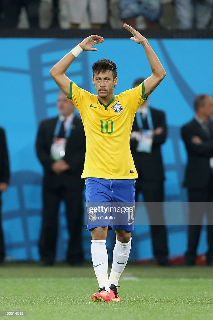Neymar of Brazil celebrates scoring his first goal during the 2014 FIFA World Cup Brazil Group A match between Brazil and Croatia at Arena de Sao Paulo on June 12, 2014 in Sao Paulo, Brazil.