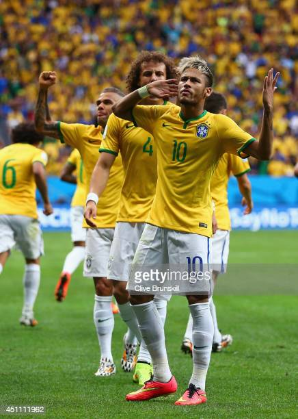 Neymar of Brazil celebrates scoring his team's first goal during the 2014 FIFA World Cup Brazil Group A match between Cameroon and Brazil at Estadio...