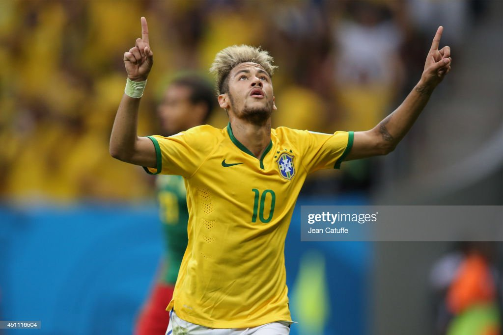 Neymar of Brazil celebrates scoring his team's second goal during the 2014 FIFA World Cup Brazil Group A match between Cameroon and Brazil at Estadio Nacional on June 23, 2014 in Brasilia, Brazil.