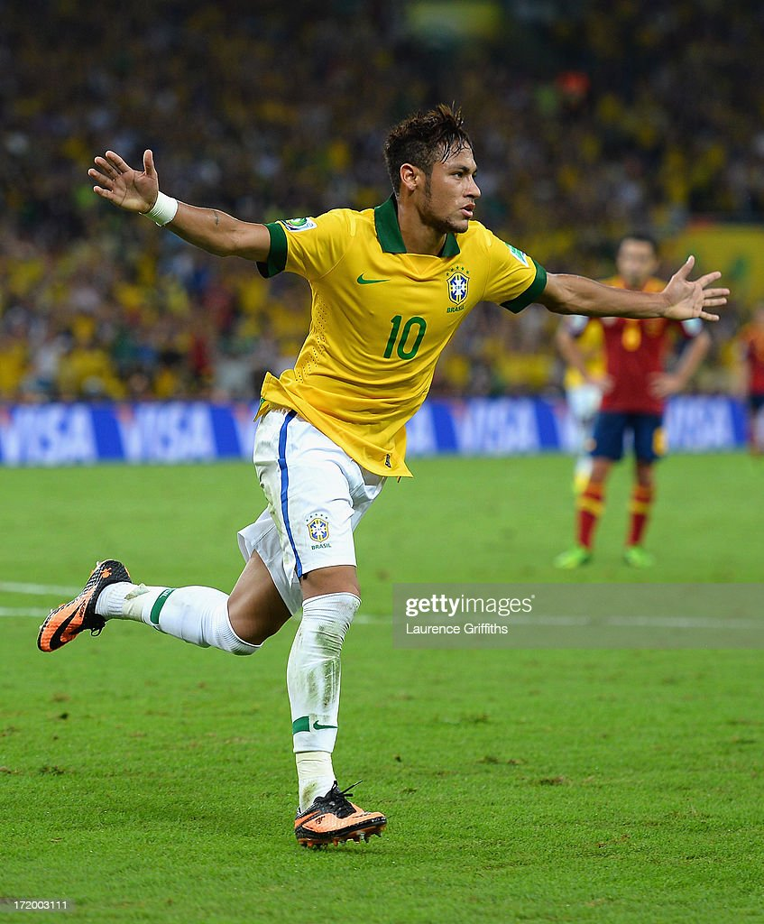 Neymar of Brazil celebrates scoring his team's second goal to make the score 2-0 during the FIFA Confederations Cup Brazil 2013 Final match between Brazil and Spain at Maracana on June 30, 2013 in Rio de Janeiro, Brazil.