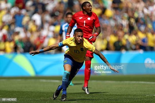 Neymar of Brazil celebrates scoring the first Brazil goal during the Men's Semifinal Football match between Brazil and Honduras at Maracana Stadium...