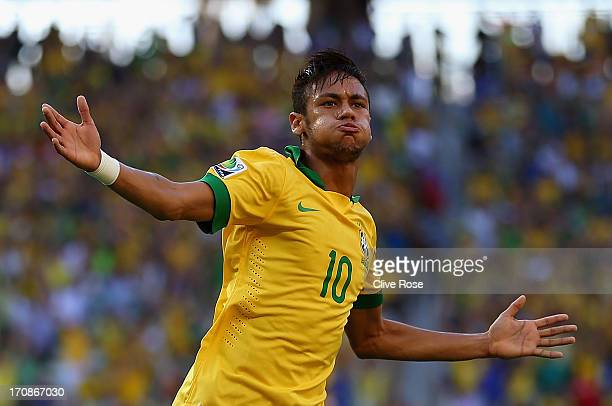 Neymar of Brazil celebrates scoring the opening goal during the FIFA Confederations Cup Brazil 2013 Group A match between Brazil and Mexico at...