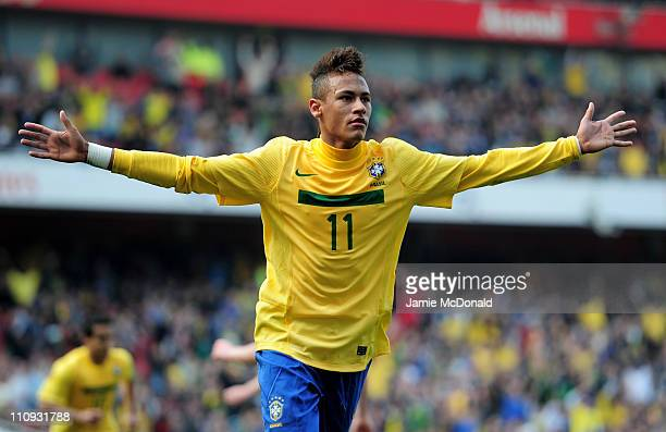 Neymar of Brazil celebrates scoring the opening goal during the International friendly match between Brazil and Scotland at Emirates Stadium on March...