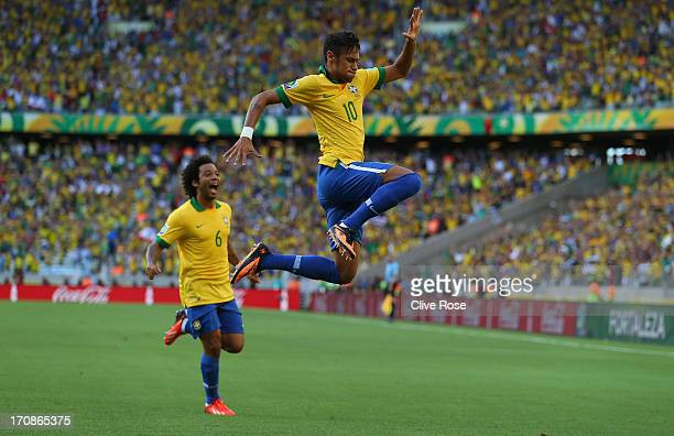 Neymar of Brazil celebrates scoring the opening goal with teammate Marcelo during the FIFA Confederations Cup Brazil 2013 Group A match between...