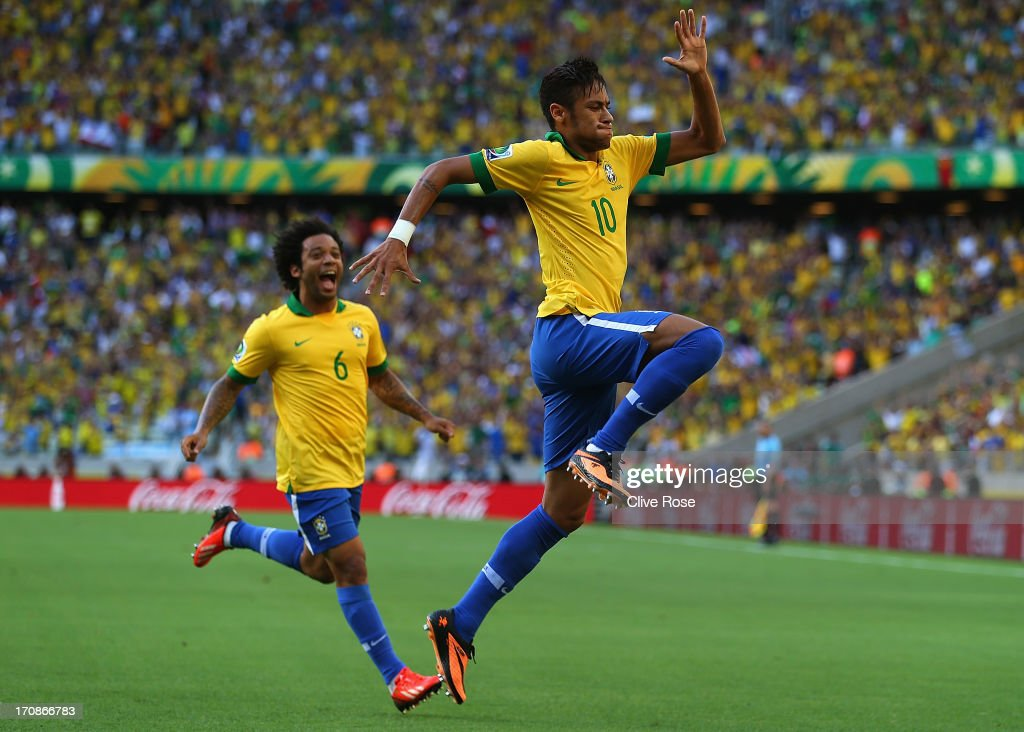 Neymar of Brazil celebrates scoring the opening goal with team-mate Marcelo (l) during the FIFA Confederations Cup Brazil 2013 Group A match between Brazil and Mexico at Castelao on June 19, 2013 in Fortaleza, Brazil.