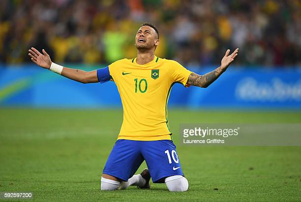 Neymar of Brazil celebrates scoring the winning penalty in the penalty shoot out during the Men's Football Final between Brazil and Germany at the...