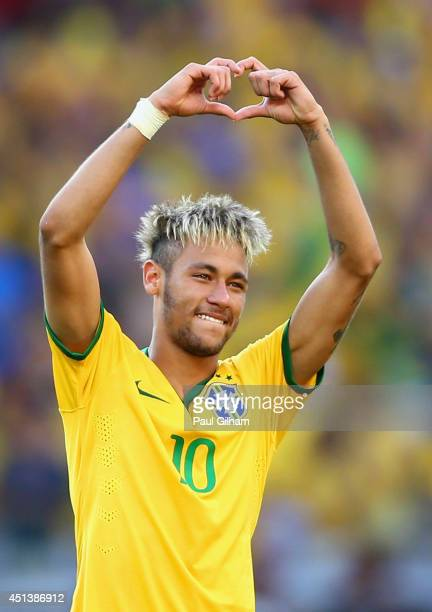 Neymar of Brazil celebrates victory after the penalty shootout against Chile in the 2014 FIFA World Cup Brazil round of 16 match between Brazil and...