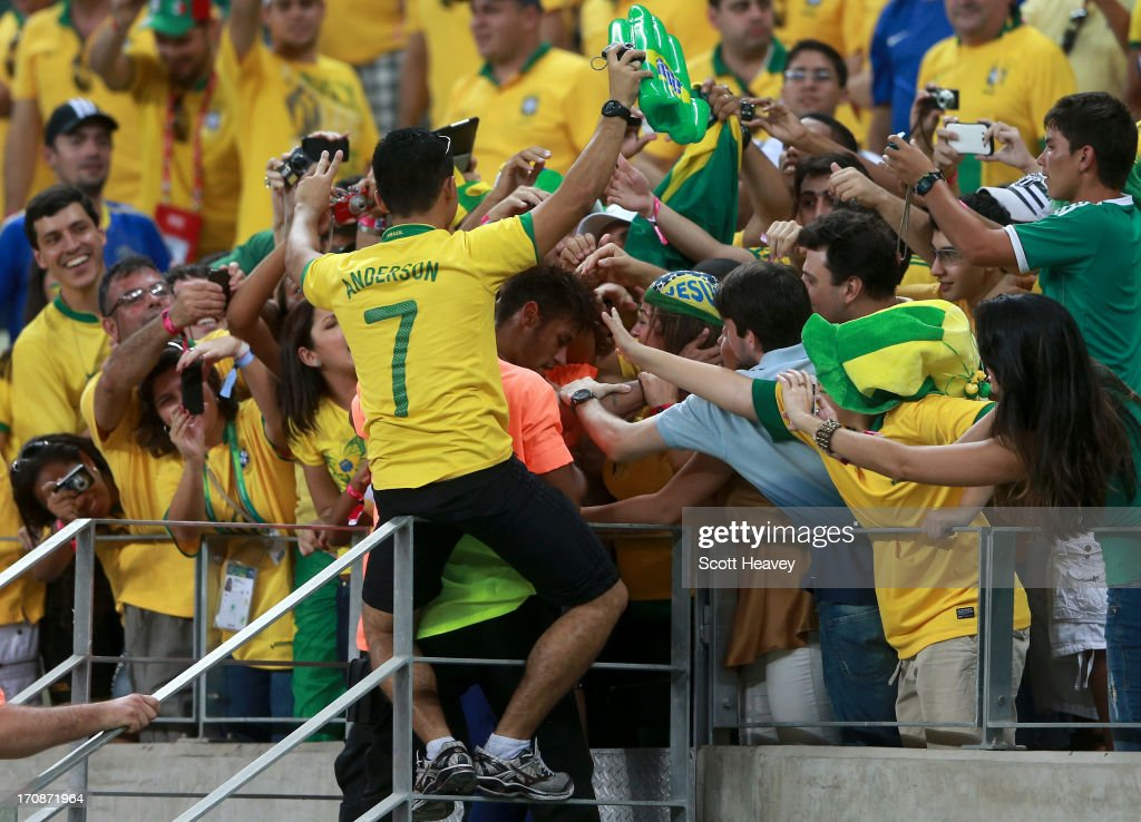 Neymar of Brazil celebrates with fans during the FIFA Confederations Cup Brazil 2013 Group A match between Brazil and Mexico at Castelao on June 19, 2013 in Fortaleza, Brazil.