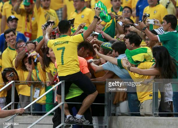 Neymar of Brazil celebrates with fans during the FIFA Confederations Cup Brazil 2013 Group A match between Brazil and Mexico at Castelao on June 19...
