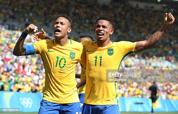 Neymar of Brazil celebrates with Gabriel Jesus after he scores Brazil's third goal during the Semi Final match between Brazil and Honduras at...