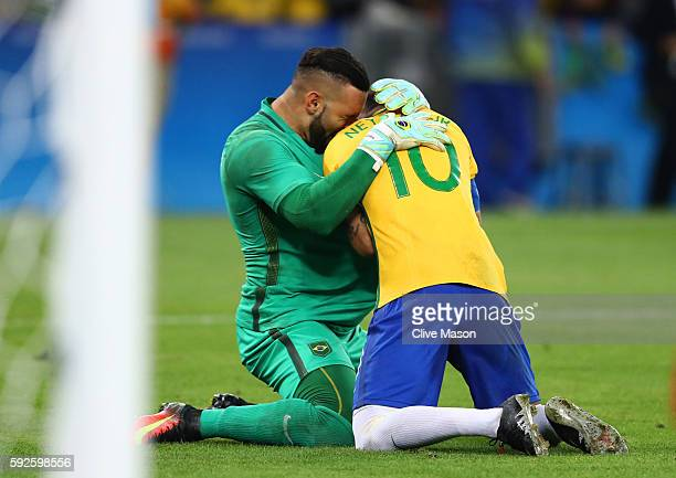 Neymar of Brazil celebrates with goalkeeper Weverton after scoring the winning penalty in the penalty shoot out during the Men's Football Final...