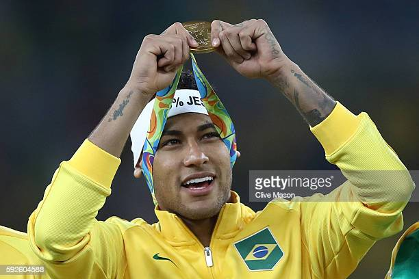 Neymar of Brazil celebrates with his gold medal following the Men's Football Final between Brazil and Germany at the Maracana Stadium on Day 15 of...
