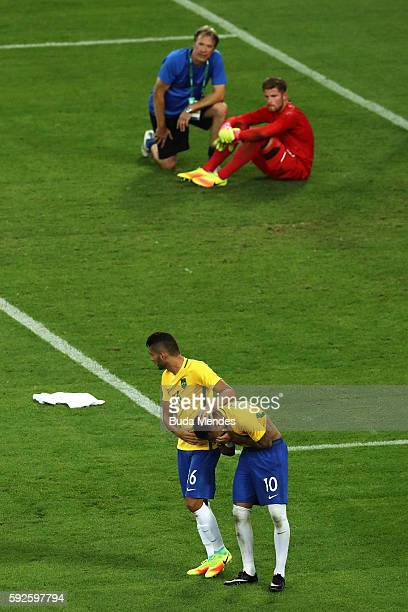 Neymar of Brazil celebrates with team mate Thiago Maia of Brazil after scoring the winning penalty in the penalty shoot out as German keeper Timo...