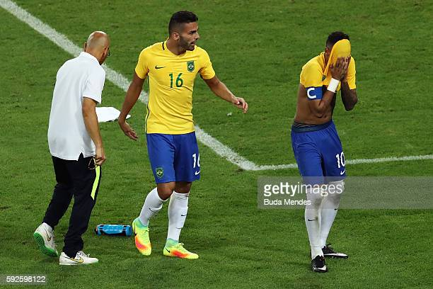 Neymar of Brazil celebrates with team mate Thiago Maia of Brazil after scoring the winning penalty in the penalty shoot during the Men's Football...