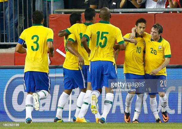 Neymar of Brazil celebrates with teammate Bernard following his goal in the first half against Portugal during the international friendly match at...