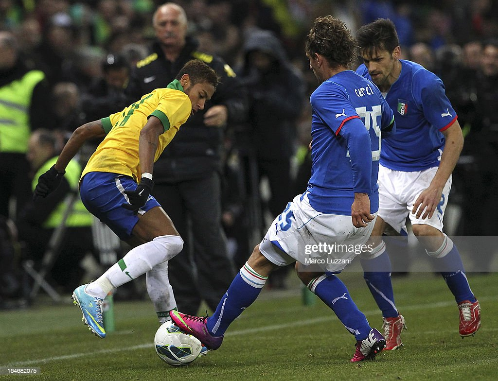 Neymar (L) of Brazil competes for the ball with Alessio Cerci (C) and <a gi-track='captionPersonalityLinkClicked' href=/galleries/search?phrase=Christian+Maggio&family=editorial&specificpeople=2131601 ng-click='$event.stopPropagation()'>Christian Maggio</a> (R) of Italy during the international friendly match between Italy and Brazil on March 21, 2013 in Geneva, Switzerland.
