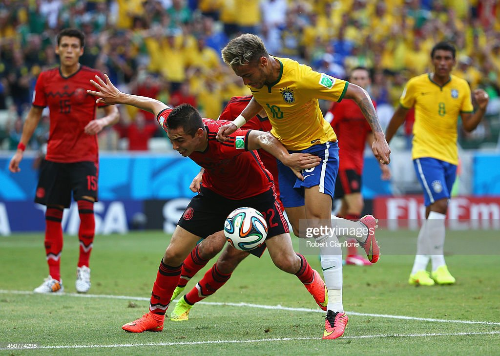 Neymar of Brazil competes for the ball with <a gi-track='captionPersonalityLinkClicked' href=/galleries/search?phrase=Paul+Aguilar&family=editorial&specificpeople=4476672 ng-click='$event.stopPropagation()'>Paul Aguilar</a> of Mexico during the 2014 FIFA World Cup Brazil Group A match between Brazil and Mexico at Castelao on June 17, 2014 in Fortaleza, Brazil.