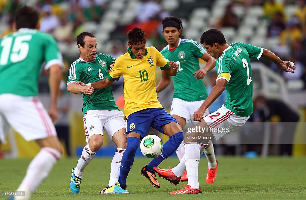 Neymar of Brazil competes with <a gi-track='captionPersonalityLinkClicked' href=/galleries/search?phrase=Gerardo+Torrado&family=editorial&specificpeople=220353 ng-click='$event.stopPropagation()'>Gerardo Torrado</a> of Mexico <a gi-track='captionPersonalityLinkClicked' href=/galleries/search?phrase=Francisco+Javier+Rodriguez&family=editorial&specificpeople=469708 ng-click='$event.stopPropagation()'>Francisco Javier Rodriguez</a> (R) during the FIFA Confederations Cup Brazil 2013 Group A match between Brazil and Mexico at Castelao on June 19, 2013 in Fortaleza, Brazil.
