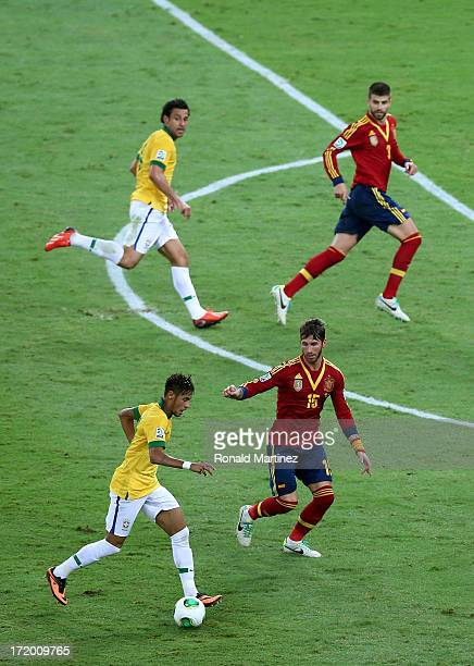 Neymar of Brazil competes with Sergio Ramos of Spain during the FIFA Confederations Cup Brazil 2013 Final match between Brazil and Spain at Maracana...