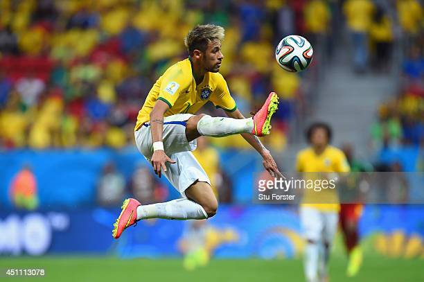 Neymar of Brazil controls the ball during the 2014 FIFA World Cup Brazil Group A match between Cameroon and Brazil at Estadio Nacional on June 23...