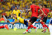 Neymar of Brazil goes down during the 2014 FIFA World Cup Brazil Group A match between Brazil and Mexico at Estadio Castelao on June 17 2014 in...