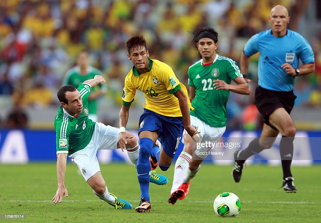 Neymar of Brazil goes past the challenge of Gerardo Torrado of Mexico during the FIFA Confederations Cup Brazil 2013 Group A match between Brazil and Mexico at Castelao on June 19, 2013 in Fortaleza, Brazil.