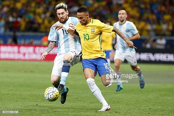 Neymar of Brazil in action against Lionel Messi of Argentina during the FIFA 2018 World Cup Qualifier match between Brazil and Argentina at Mineirao...