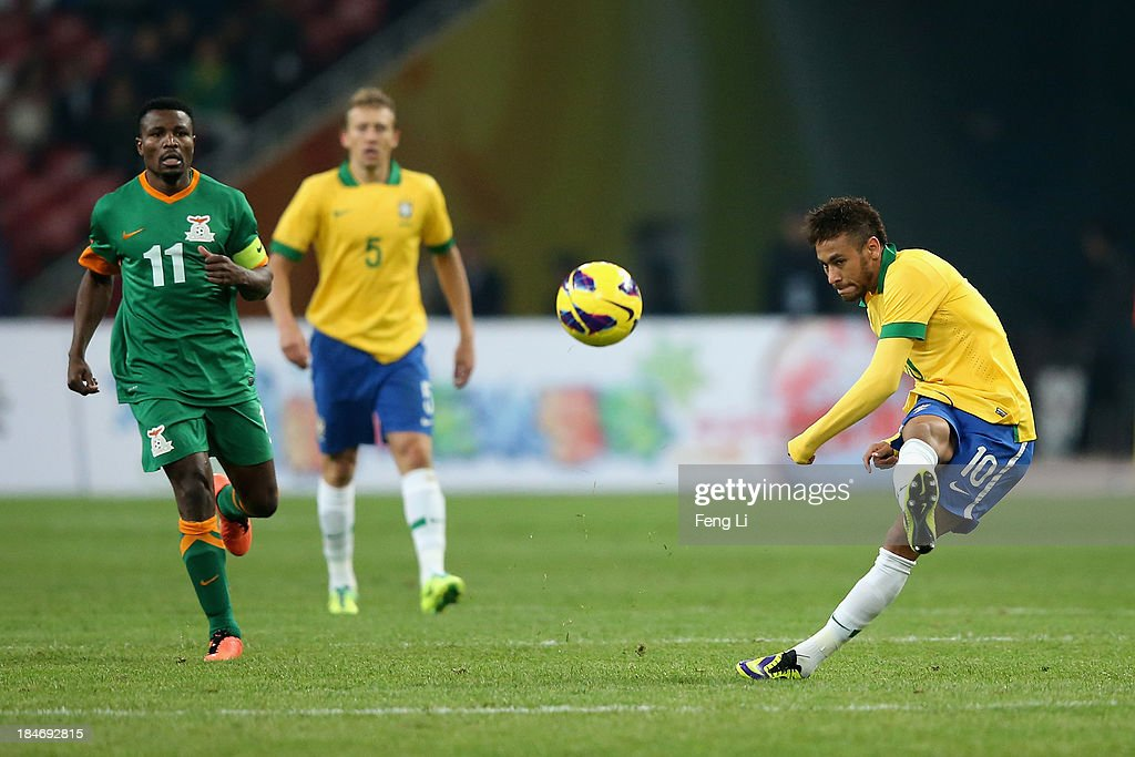 Neymar of Brazil (Right) in action during the international friendly match between Brazil and Zambia at Beijing National Stadium on October 15, 2013 in Beijing, China.