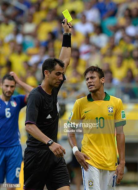 Neymar of Brazil is booked by Referee Ravshan Irmatov during the FIFA Confederations Cup Brazil 2013 Group A match between Italy and Brazil at...