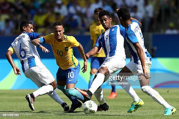 Neymar of Brazil is challenged by Bryan Acosta of Honduras Antony Lozano of Honduras and Marcelo Pereira of Honduras during the Men's Semifinal...