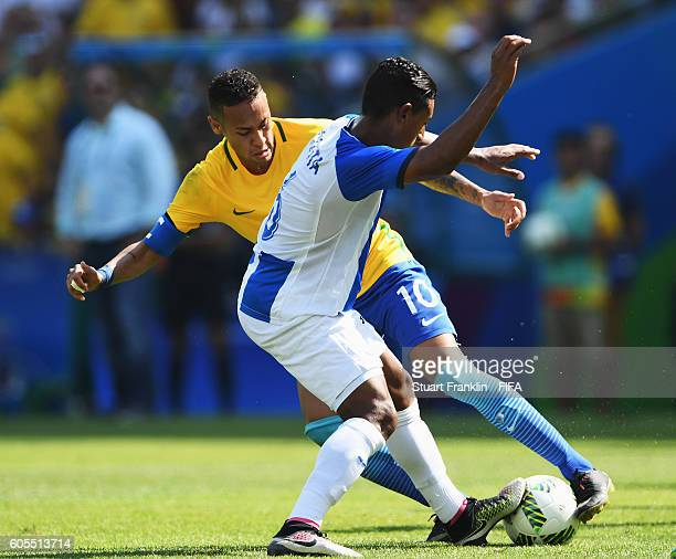 Neymar of Brazil is challenged by Bryan Acosta of Honduras during the Olympic Men's semi final match between Brazil and Honduras at Maracana Stadium...