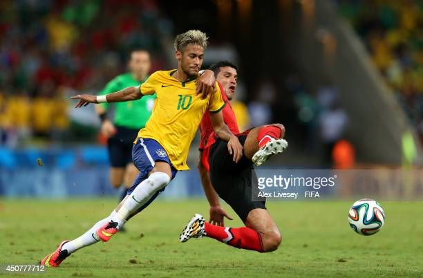 Neymar of Brazil is challenged by Francisco Javier Rodriguez of Mexico during the 2014 FIFA World Cup Brazil Group A match between Brazil and Mexico...