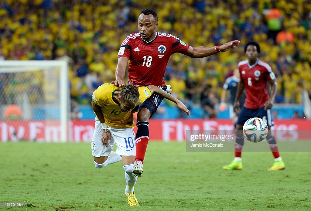 Neymar of Brazil is challenged by Juan Camilo Zuniga of Colombia during the 2014 FIFA World Cup Brazil Quarter Final match between Brazil and Colombia at Castelao on July 4, 2014 in Fortaleza, Brazil. This tackle resulted in injury to Neymar and ended the player's World Cup.