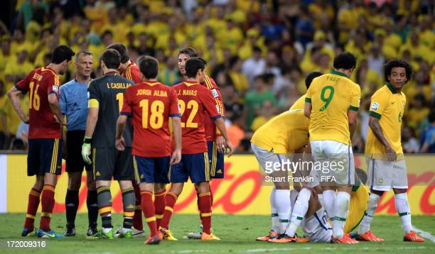 Neymar of Brazil is checked on by his teammates following a red card challenge by Gerard Pique of Spain during the FIFA Confederations Cup Brazil...