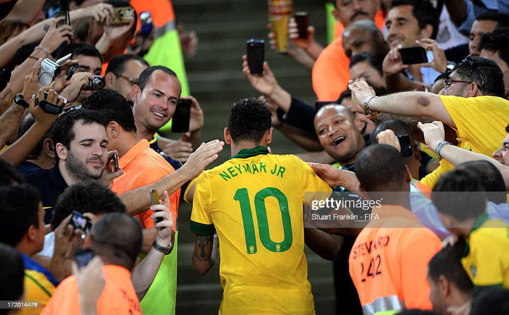 Neymar of Brazil is congratulated by fans at the end of the FIFA Confederations Cup Brazil 2013 Final match between Brazil and Spain at Maracana on June 30, 2013 in Rio de Janeiro, Brazil.