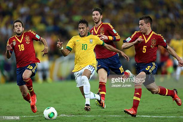 Neymar of Brazil is pursued by Jordi Alba Sergio Ramos and Cesar Azpilicueta of Spain during the FIFA Confederations Cup Brazil 2013 Final match...