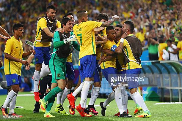 Neymar of Brazil is surrounded by team mates as he opens the scoring during the Men's Football Final between Brazil and Germany at the Maracana...